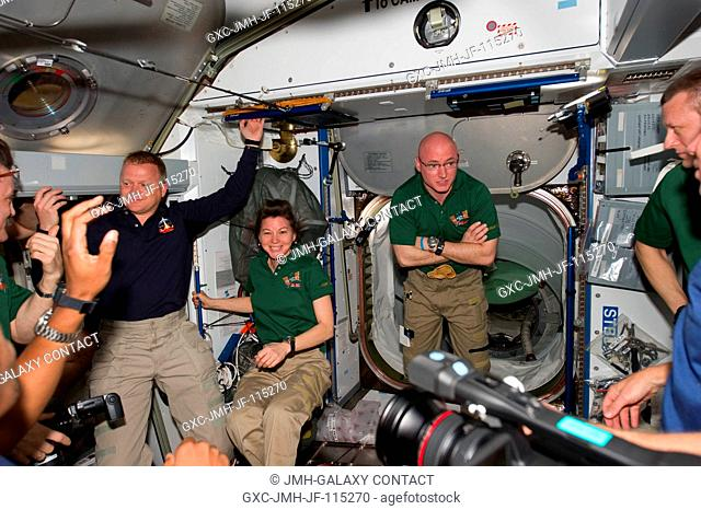 STS-133 and Expedition 26 crew members are pictured in the Harmony node of the International Space Station shortly after space shuttle Discovery and the space...