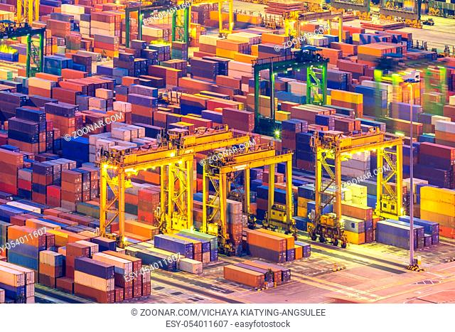 Aerial view of Industrial port with container ship at dusk