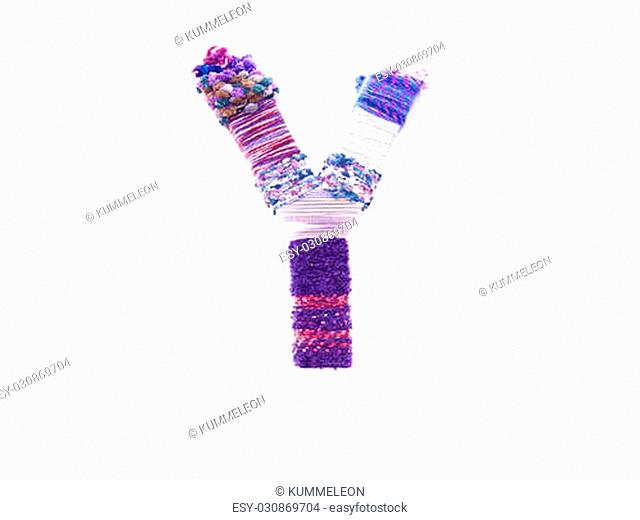 the letter y created with brightly coloured knitting yard