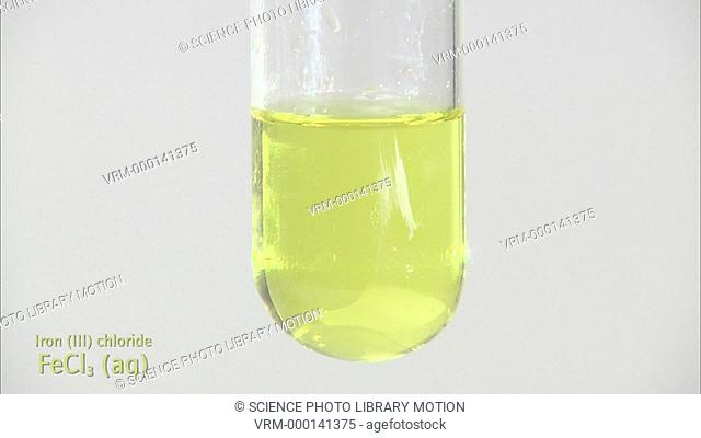 Iron (III) hydroxide precipitate, formed as sodium hydroxide is dripped into iron (III) chloride solution