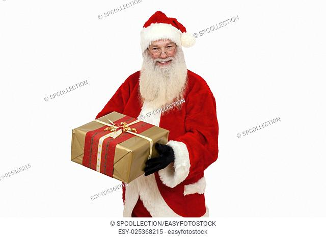Santa Claus holding a gift in hand (isolated)