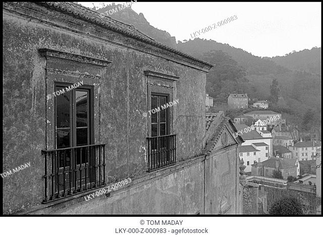 Home in Portugal with town and hills in background