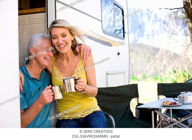 Older couple camping with RV
