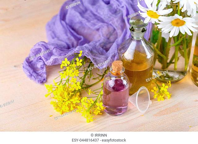 Bottles with tinctures or oil from medicinal herbs and wild flowers. Herbal medicine