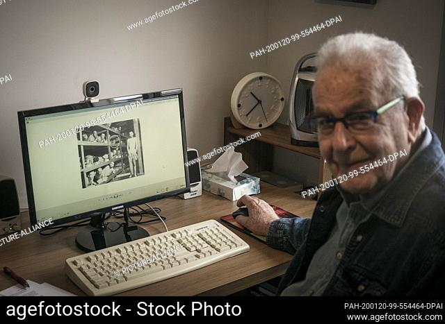 20 January 2020, Israel, Haifa: Naftali Fürst, an 87-year-old Holocaust survivor, shows a photo of him and other prisoners in Buchenwald concentration camp on...