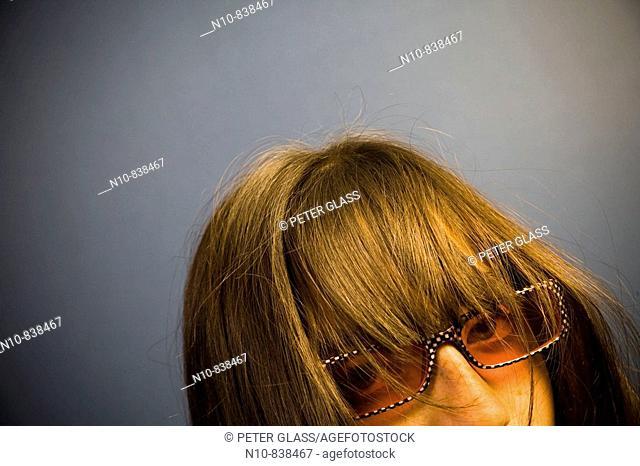 Preteen girl, wearing sunglasses, posing