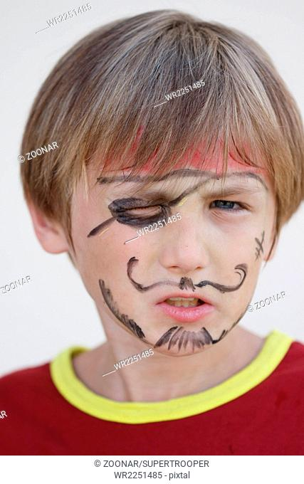Close-up of grumpy pirate boy