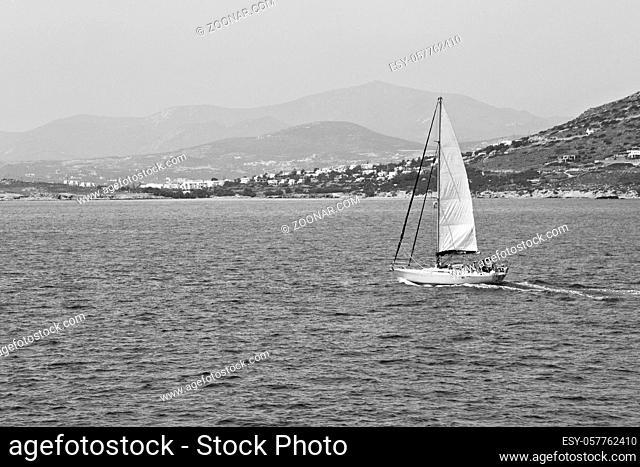 sailing in europe greece santorini island hill and rocks on the summertime beach