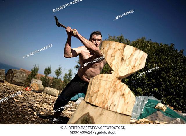 Jose Mari Olasagasti, wood cutter or aizkolari in Basque language  He is training in his farm in Igeldo mountain, near San Sebastian  Basque rural sports Herri...