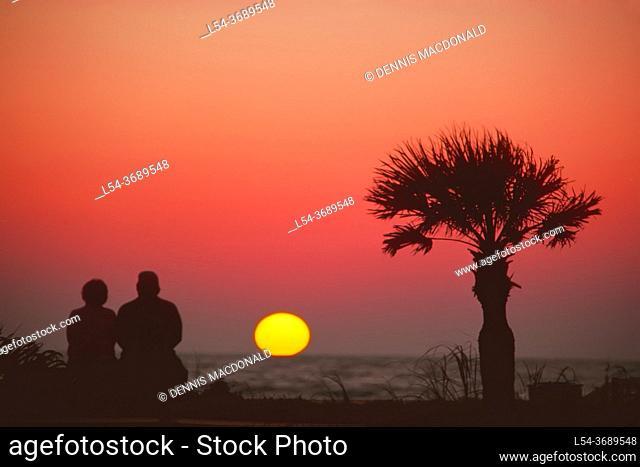 . . senior couple view sunset together on Naples Beach, Florida