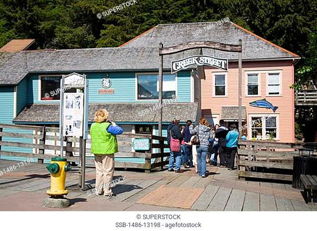People in front of a building, Creek Street, Ketchikan, Alaska, USA