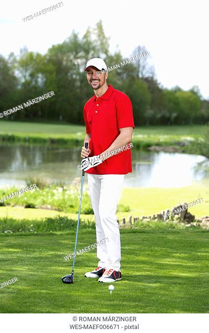 Germany, Bavaria, Mature man on golf course