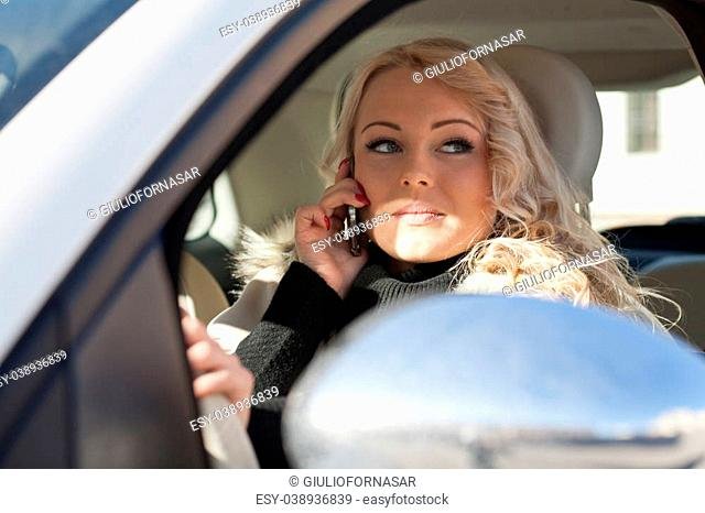 beautiful woman driving and phoning dangerous behavior