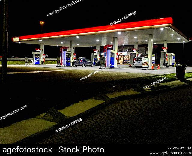 Noord-Brabant, Netherlands. Gas and Fuel Station Alonside Highway at Night