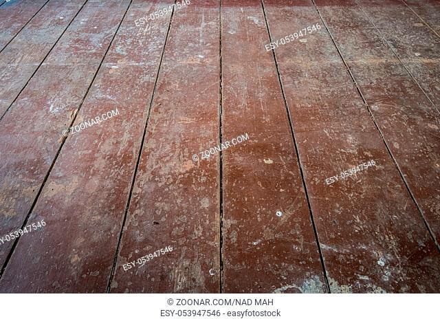 old wooden board floor / floorboards in apartment room before refurbishment -