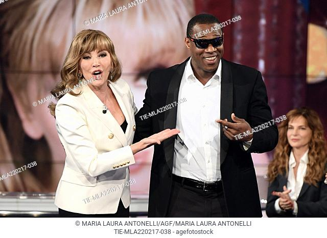 Host Milly Carlucci with the competitor Oney Tapia during the tv show Porta a porta, Rome, ITALY-21-02-2017