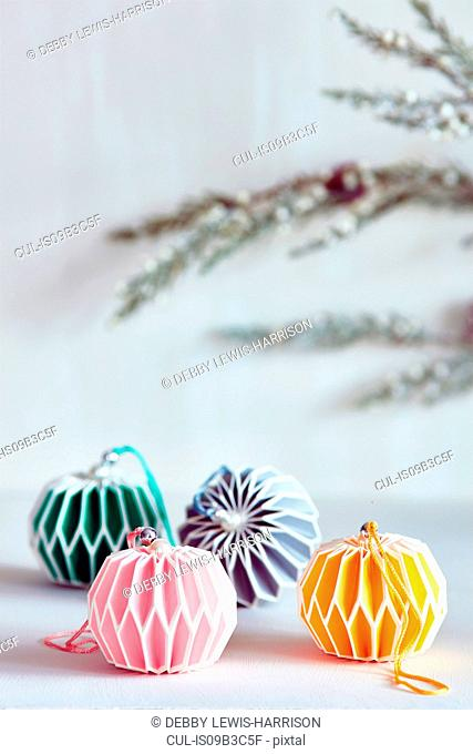 Colourful Christmas baubles with colour coordinated ribbon
