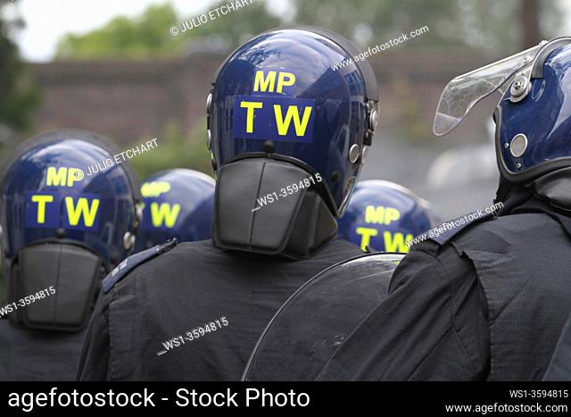 Police and rioters in confrontation after damaged caused by rioters in Hackney, London, UK