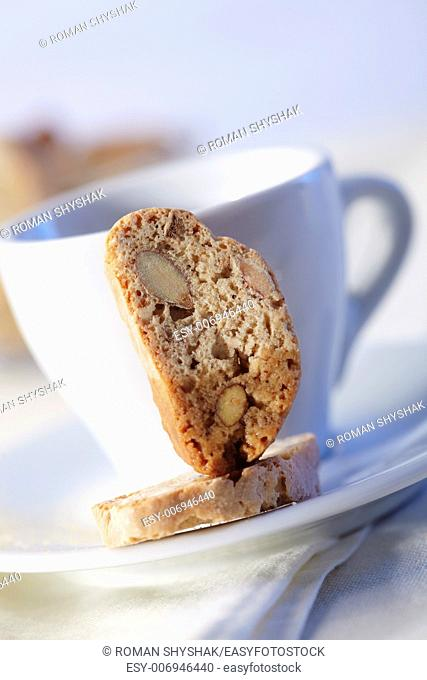 Cantucci cakes with coffee on background