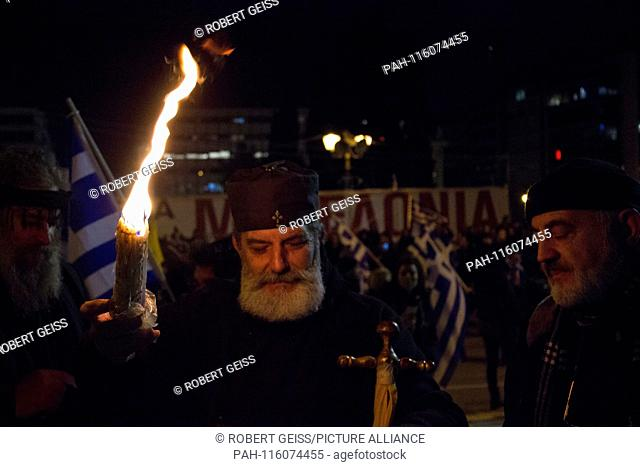 Greek Orthodox priest and Greeks during protest against name change FYROM in Northern Macedonia. 24.01.2019 | usage worldwide. - Athen/Greece