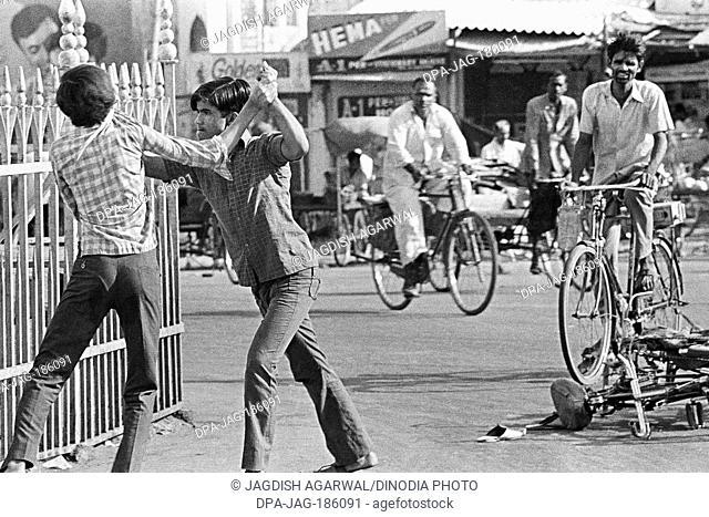 Men fighting on street Charminar Hyderabad Andhra Pradesh India Asia 1974