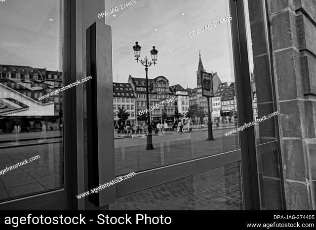 Street reflection on glass door, Old Lamp, Strasbourg, Alsace, France, Europe