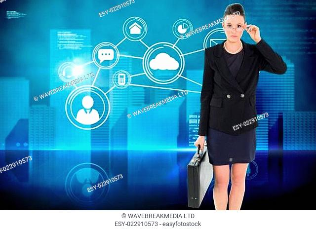 Composite image of elegant businesswoman in suit carrying briefcase