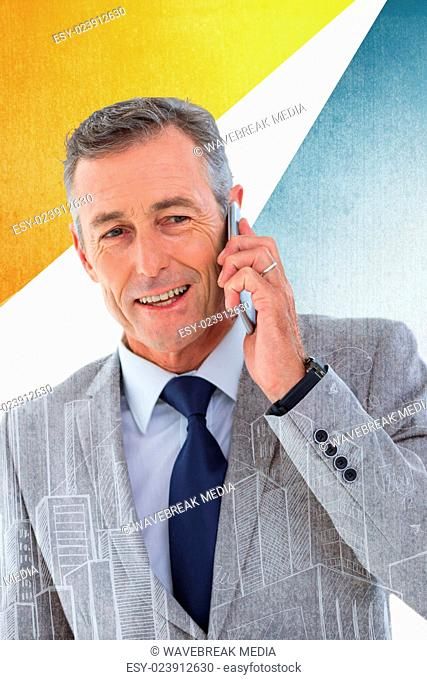 Composite image of portrait of buisnessman taking on mobile phone
