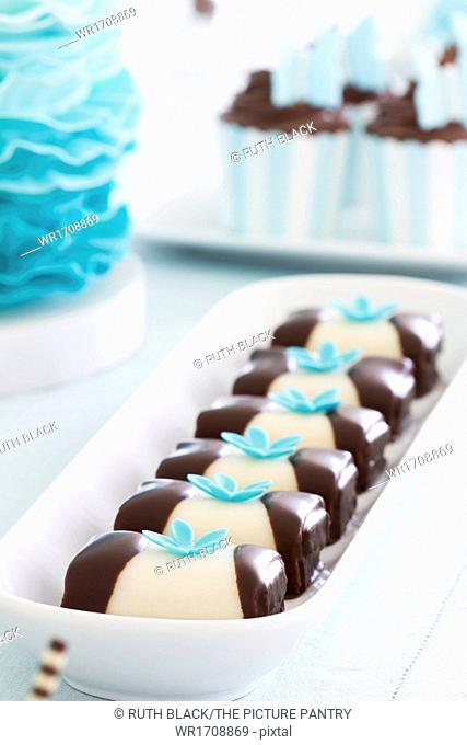 Cakes arranged on a dessert table
