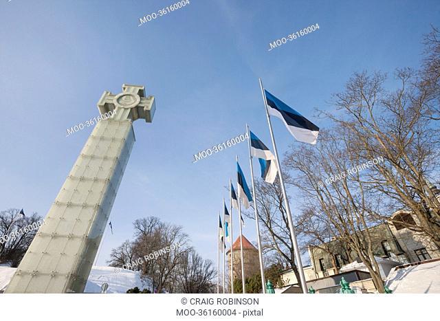 Low angle view of Freedom Monument and flagpoles, Tallinn, Estonia, Europe