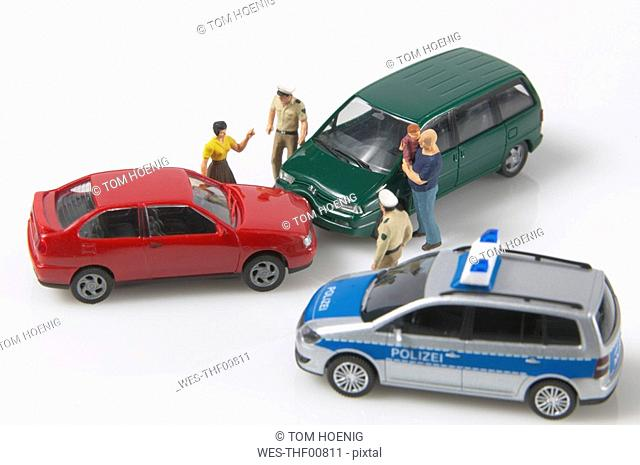 Toy cars in accident, elevated view