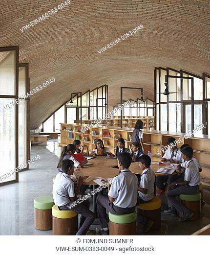 Interior view with students at work. Maya Somaiya Library, Kopargaon/Maharashtra, India. Architect: Sameep Padora and associates (SP+A), 2018