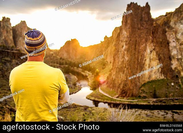Caucasian man admiring scenic desert landscape, Smith Rock State Park, Oregon, United States