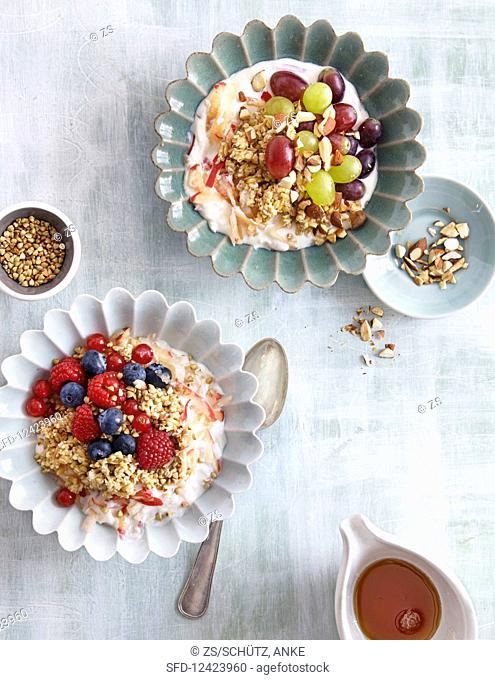 Buckwheat cereal with berries, and almond muesli with grapes