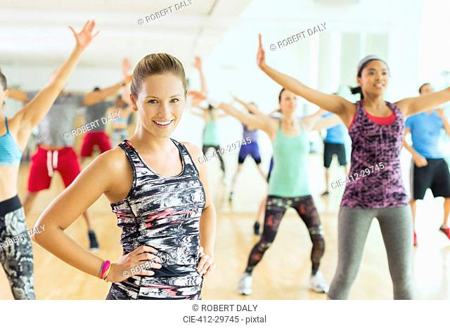 Portrait smiling woman in exercise class
