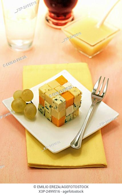 Cheese cube with grape coulis