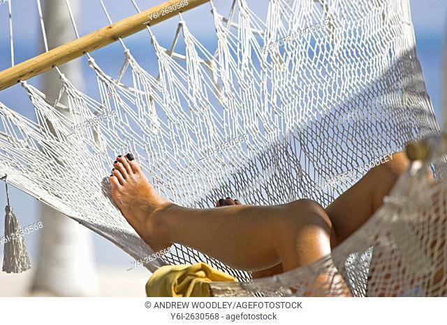 Womans legs in hammock Isla Mujeres Mexico