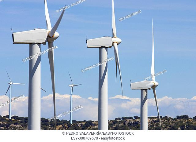 group of modern windmills and hills in Buste, Saragossa, Aragon, Spain