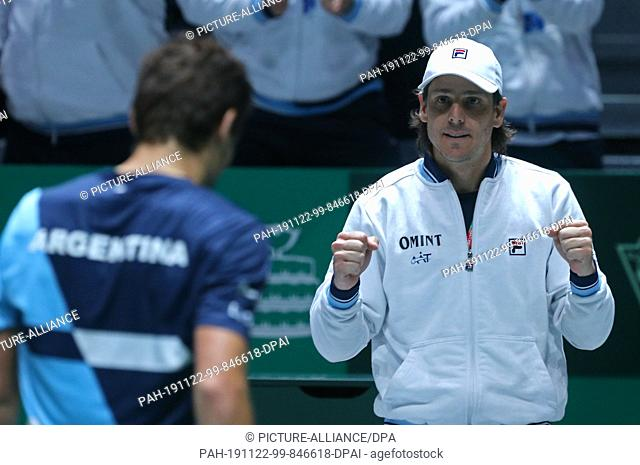 22 November 2019, Spain, Madrid: The tennis player Guido Pella from Argentina with the captain's team Gastón Gaudio plays versus Pablo Carreño Busta from Spain