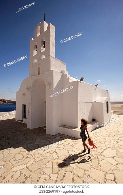Woman in front of the Chrisopigi monastery, Sifnos, Cyclades Islands, Greek Islands, Greece, Europe
