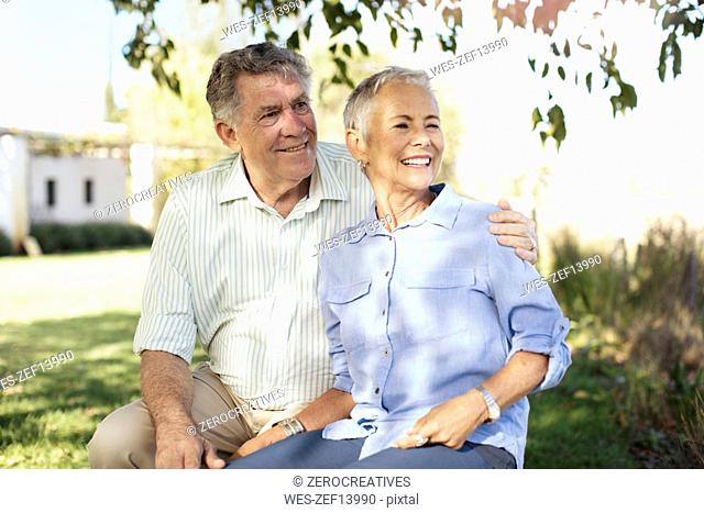 Happy senior couple in garden