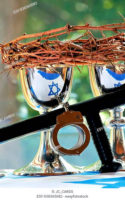 Silver chalices with the crown of thorns, a handcuff and a baton