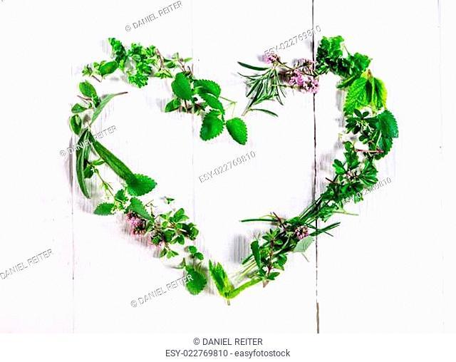 Heart shaped frame of fresh culinary herbs