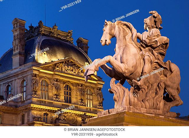 Equestrian statue of Louis XVI at entrance to Musee du Louvre, Paris France
