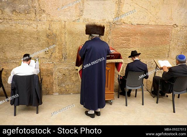 Jews praying during sabbath inside Western Wall. Western Wall in the Old City of Jerusalem, a place of prayer and pilgrimage sacred to the Jewish people