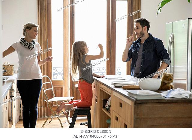 Family together at home in kitchen
