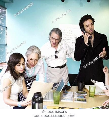 Business people discussing in board room, elevated view