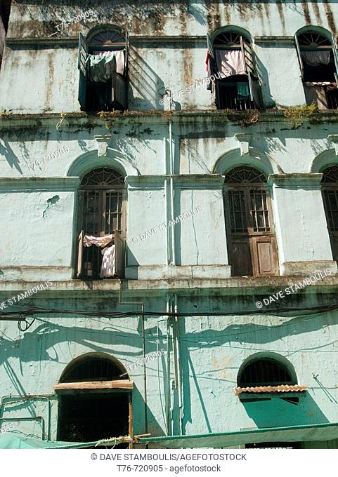 Decaying colonial leftover buildings that serve as apartments in Rangoon in Burma