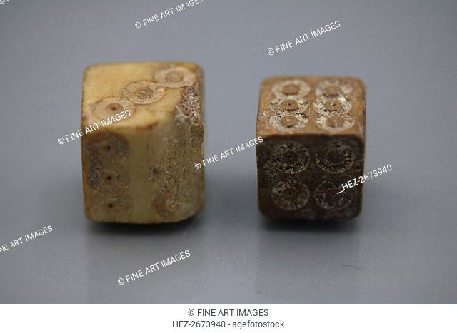 A pair of Roman dice made from carved bone, 1st century BC
