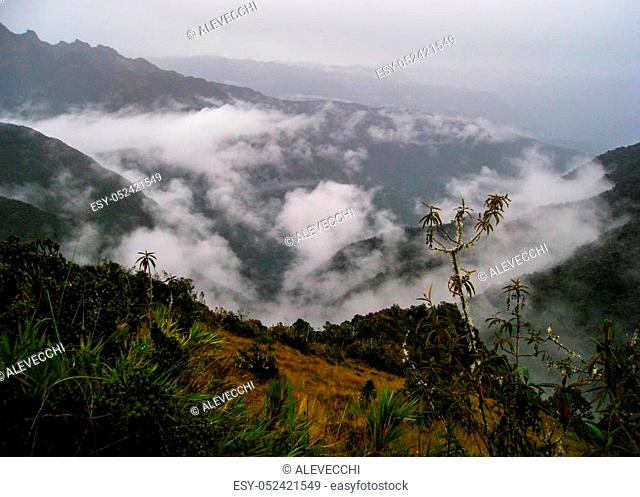 Panoramic view from the Inca Trail of the Sacred Valley with intense low clouds. Peru. South America. No people